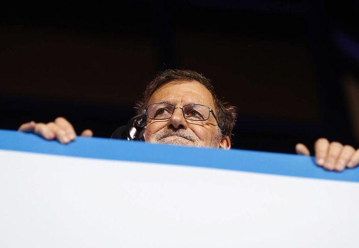 El partido del presidente del gobierno de España en funciones, Mariano Rajoy, ganó las elecciones del domingo. Pero para asumir, deberá negociar con las otras fuerzas políticas. (AP)