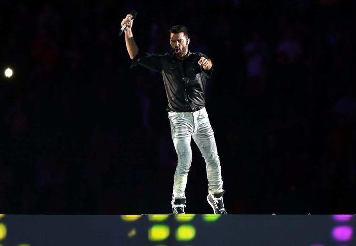 Ricky Martin durante su actuación en la clausura de los Juegos Centroamericanos y del Caribe en Boca del Río, Veracruz. El cantante boricua se presentará en Campeche el 16 de diciembre. (Notimex)