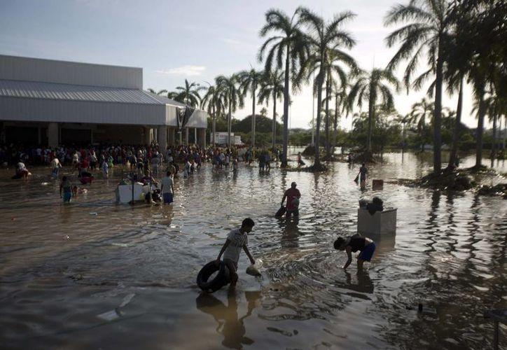 La mala planeación y corrupción en el desarrollo de la zona Punta Diamante en Acapulco son las causas del desastre. (Agencias)
