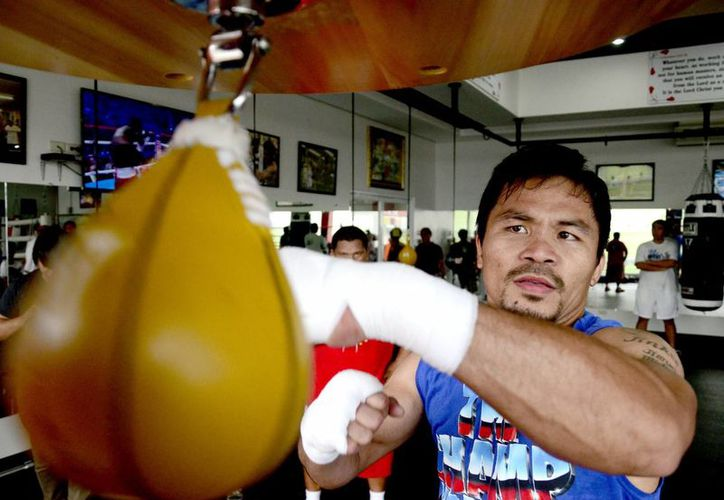 Manny Pacquiao (foto) es el primer retador en peso welter. El campeón es Floyd Mayweather. (EFE/Archivo)
