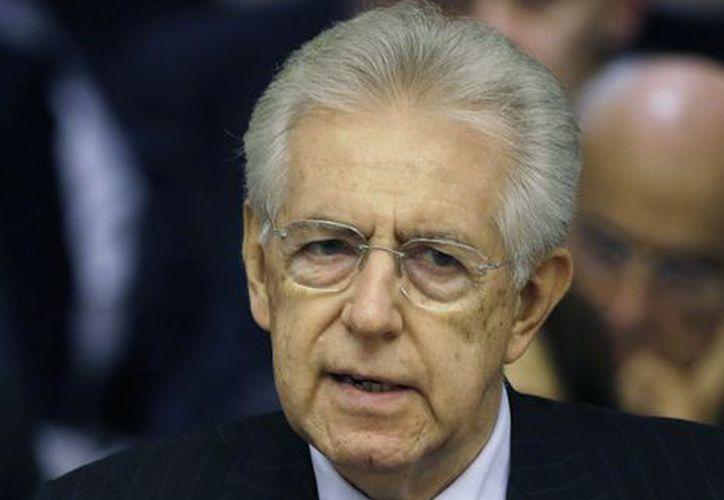 A Monti se le solicitó que quedara al mando interino del gobierno hasta que se efectuen las elecciones en febrero. (Agencias)