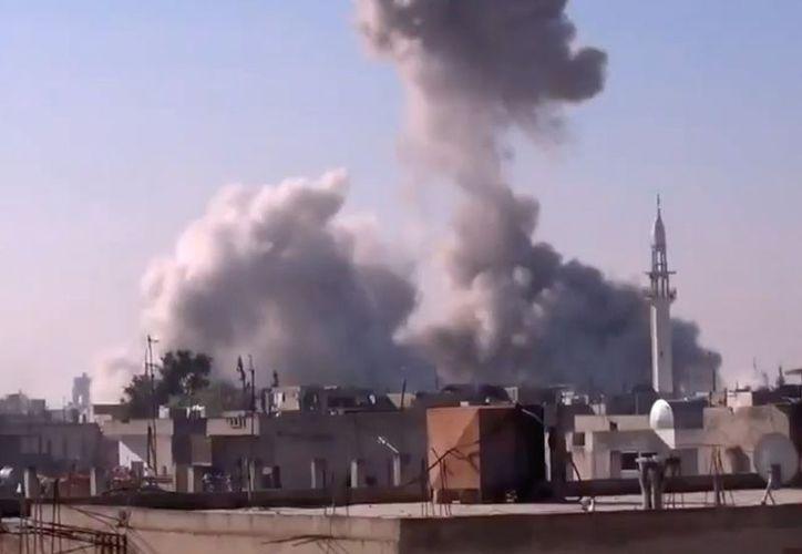 Bombardeo en Homs, Siria. La foto corresponde al jueves 27 de diciembre. (Agencias)