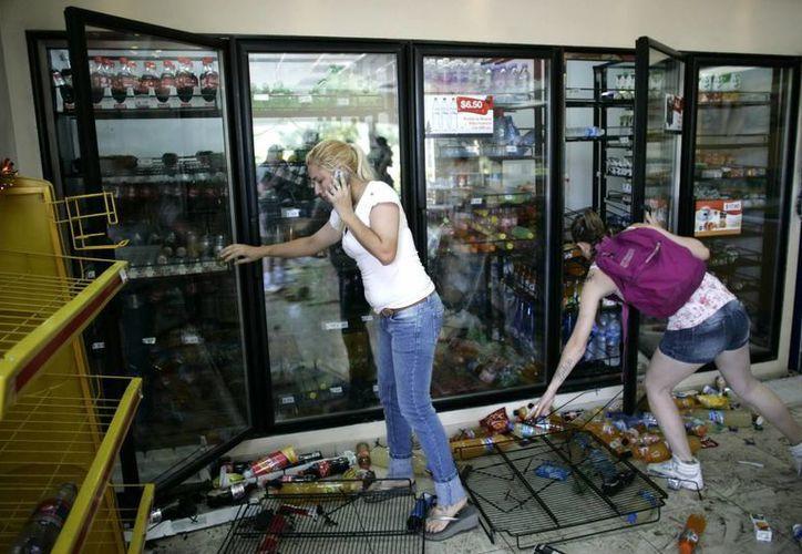 Las protestas de los agentes provocaron violentos saqueos. (Archivo/EFE)