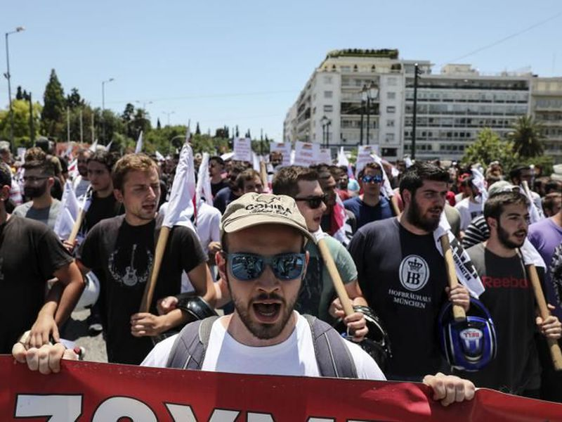 Protesters chant slogans during an anti-austerity rally in Athens. (AP)