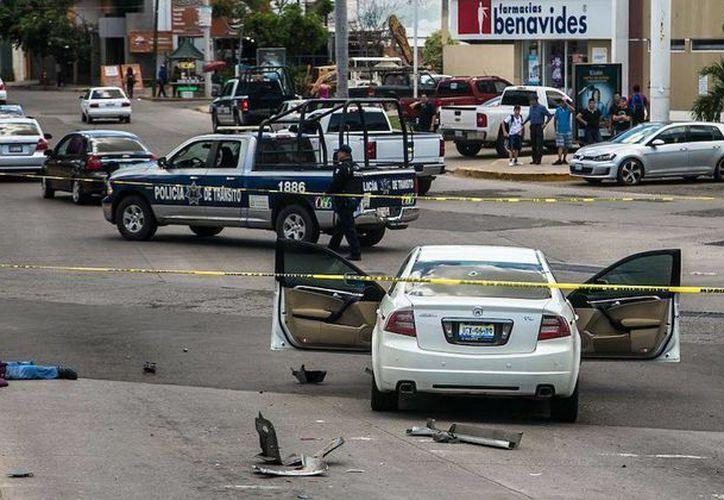 Los reportes policiacos indican que las víctimas fueron perseguidas hasta llegar al cruce del Malecón Niños Héroes, donde los agresores les dieron alcance. (sinembargo.mx)