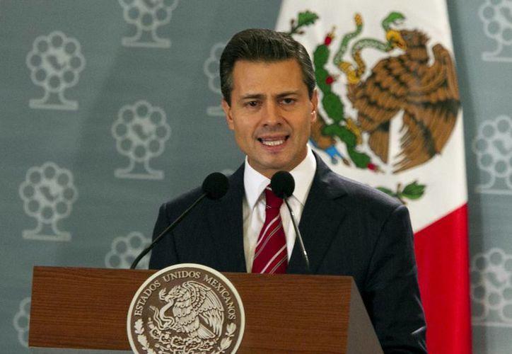 Peña Nieto informó que se prevé presentar este año las reformas energética y hacendaria. (Archivo/Notimex)