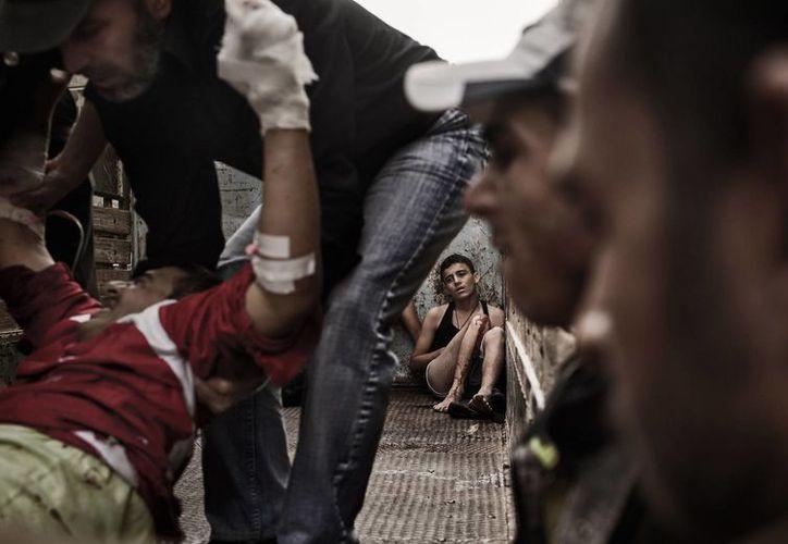 Hay millones de refugiados en los países vecinos a Siria. (Agencias)