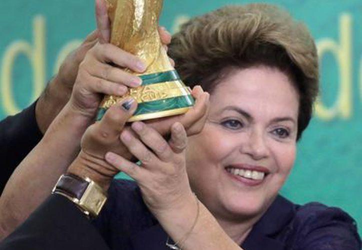 Dilma Rousseff aseguró que pudieron acabar con las dudas de quienes dudaban sobre la capacidad de Brasil. (Foto: AP)