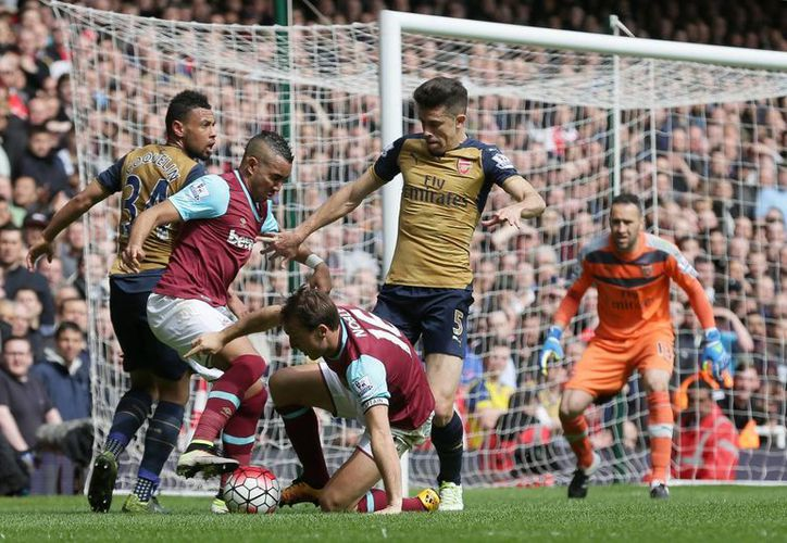 Arsenal arribó a 59 unidades para mantenerse en la tercera posición de la Liga Premier. (AP)