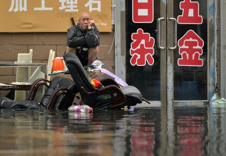 Las imágenes de las inundaciones en China son desoladoras: miles de personas han perdido su patrimonio. (AP)