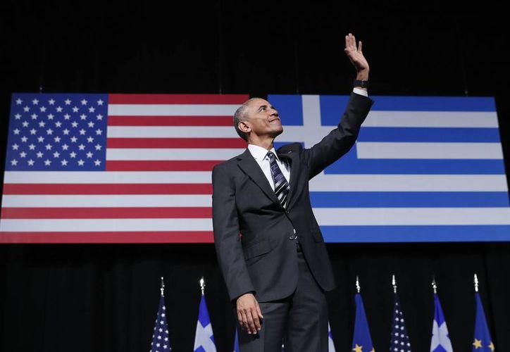 Obama tras su discurso en el Centro Cultural Stavros Niarchos, en Atenas. (AP/Pablo Martinez Monsivais)