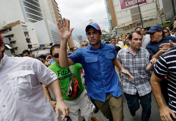 Capriles en un principio exigió a las autoridades electorales una auditoría de todo el proceso. (Agencias)