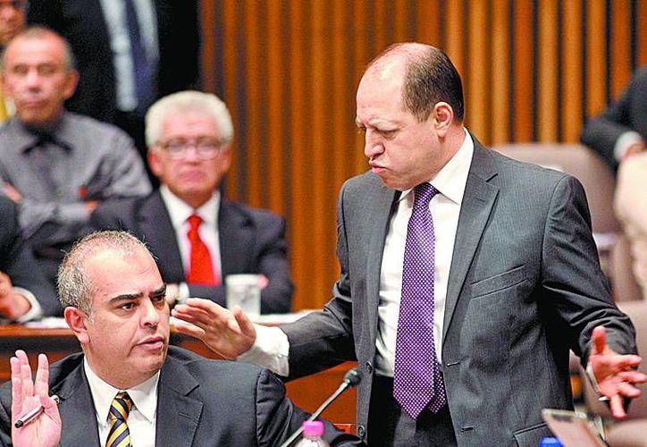 Los consejeros Alfredo Figueroa y Marco Antonio Baños. (Milenio)