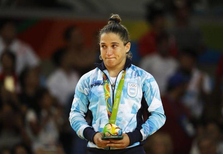 Paula Pareto ya era una histórica del deporte argentino como la primera en ganar una presea en judo -cuando se colgó el bronce en Beijing 2008. (AP/ Markus Schreiber)