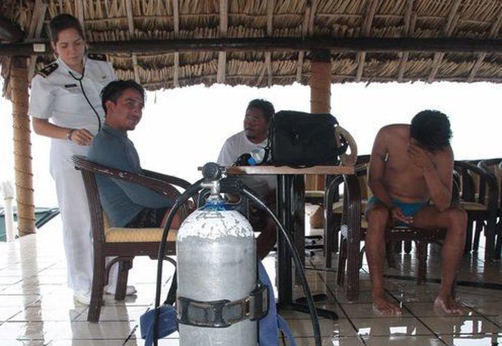 Los buzos pescadores se encuentran en buen estado de salud. (Julián Miranda/SIPSE)