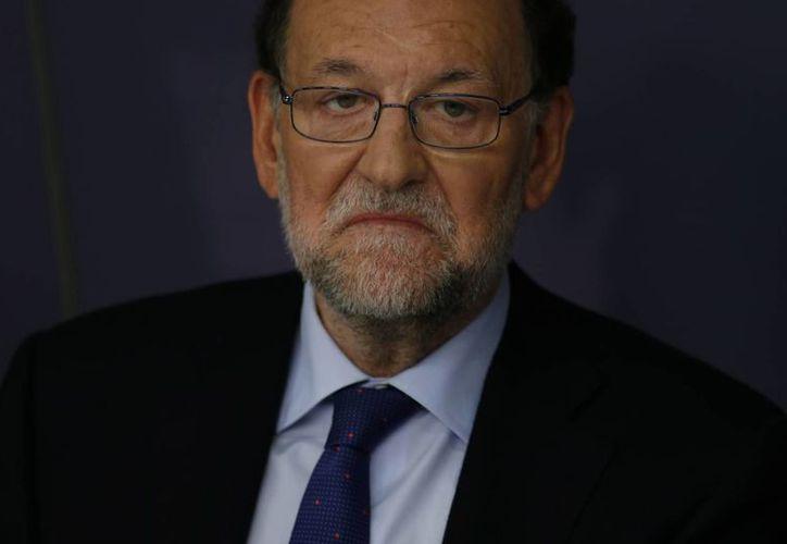 El presidente del gobierno de España, Mariano Rajoy, dijo el lunes estar dispuesto a dialogar para formar un gobierno de coalición. (AP)