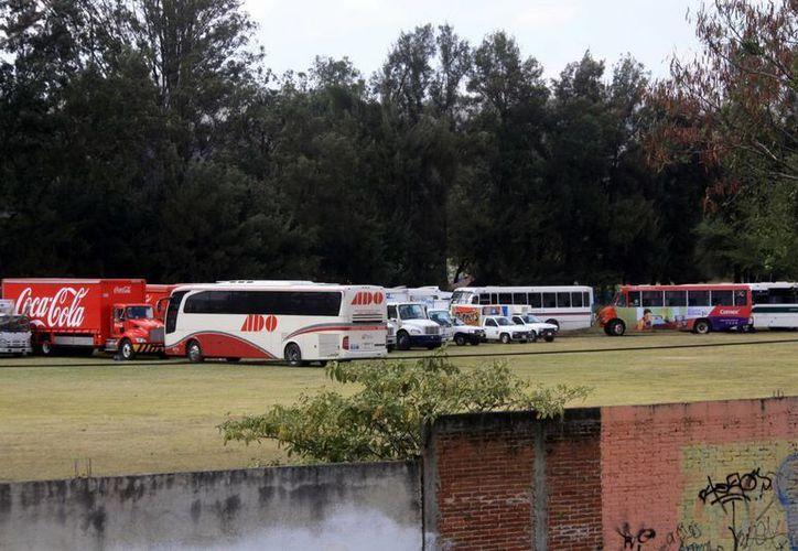 Como parte de las protestas por la desaparición de normalistas en Guerrero, en algunos casos manifestantes se apropiaron de unidades de transporte público. (Notimex/Foto de contexto)