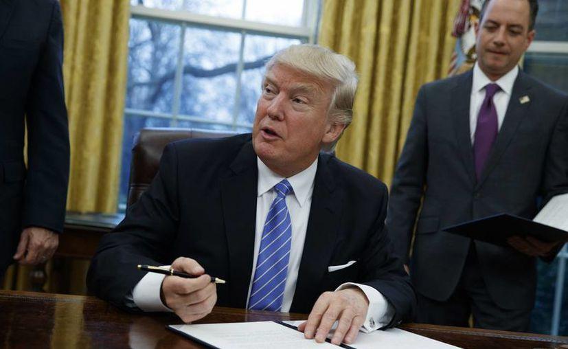 Desde el inicio de su campaña, Donald Trump prometió poner orden en el sistema migratorio de Estados Unidos. (AP/Evan Vucci)