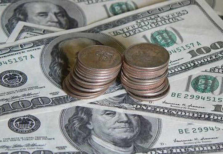 Las reservas internacionales se han elevado en 11 mil 744 millones de dólares, con respecto al cierre de 2013. (Foto especial tomada de Milenio)