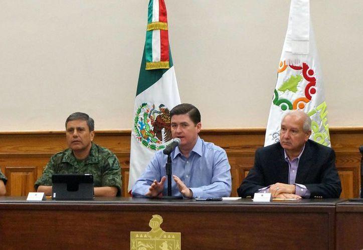 El gobernador Rodrigo Medina indicó que se desplegará un intenso operativo de seguridad en Monterrey y su zona metropolitana por la ola de violencia registrada en las horas recientes. (EFE)