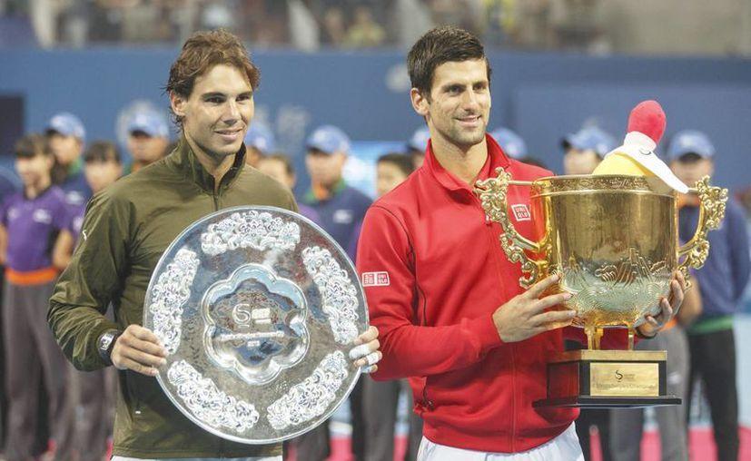 De los 39 encuentros entre los mejores del mundo, 22 se los llevó el tenista ibérico. (Foto: EFE)