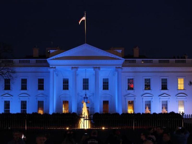 The White House is lit with blue lights in honor of World Autism Awareness Day in Washington.