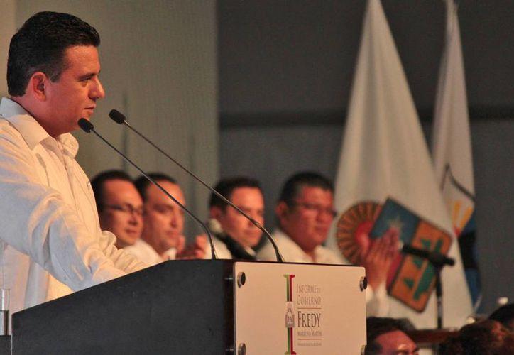 El presidente municipal de Cozumel, Fredy Marrufo Martín, rindió ayer su primer informe de gobierno.  (Gustavo Villegas/SIPSE)