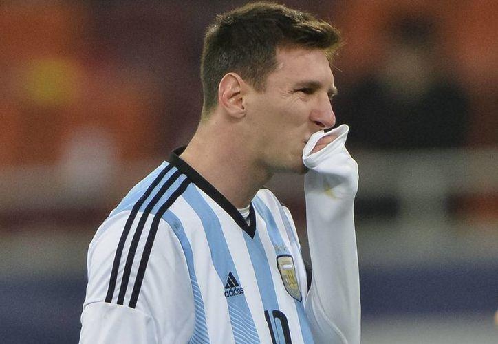 Después que Lionel Messi vomitó en el partido de Argentina contra Rumania, el delantero jugó sin problemas, aunque tampoco pesó mucho en el desenlace del encuentro. (Agencias)