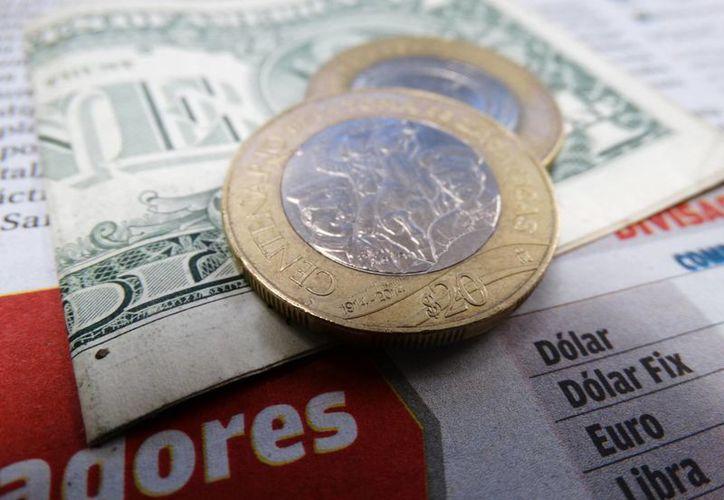 El dólar  se compró en un mínimo de 19.08 pesos en bancos de la Ciudad de México. (Christian Coquet/SIPSE.com)