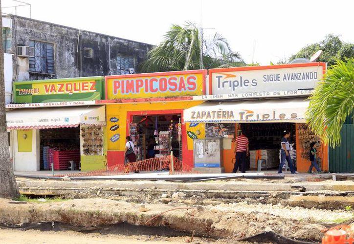 Afiliados a la Canaco dicen que por el tamaño de la obra en avenida De los Héroes hay un impacto negativo económicamente. (Harold Alcocer/SIPSE)