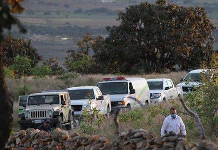 Las autoridades indican que podrían hallarse más cuerpos en las fosas clandestinas localizadas en Zapopan. (Milenio)