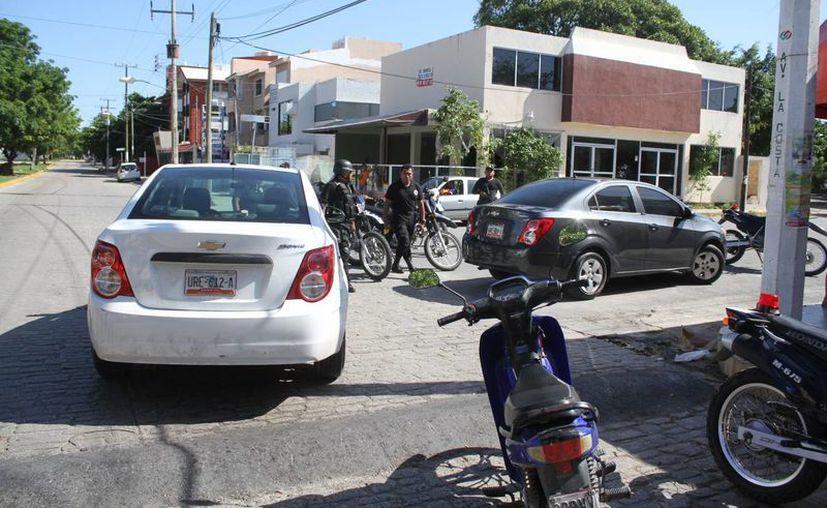 Revisan estacionamientos públicos y de centros comerciales. (Eric Galindo/SIPSE)