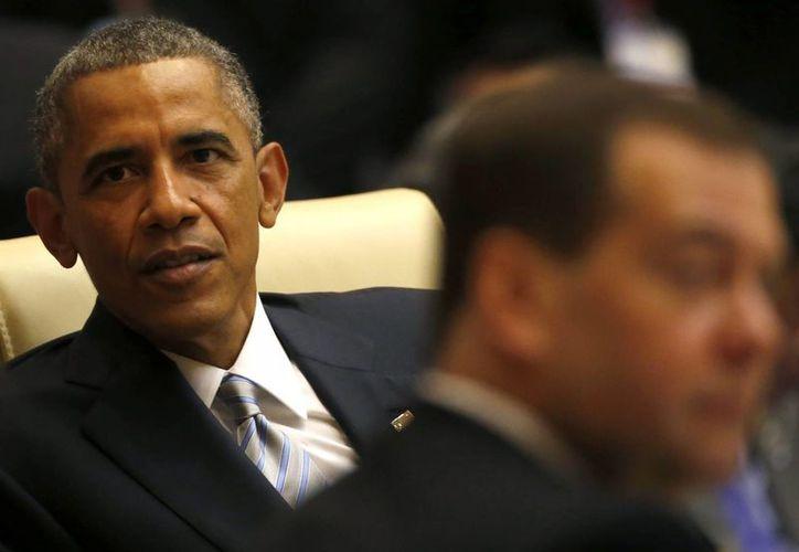 Barack Obama haría el anuncio de una medida de alivio migratorio en cuanto regrese de una gira que está realizando en Asia. (EFE)