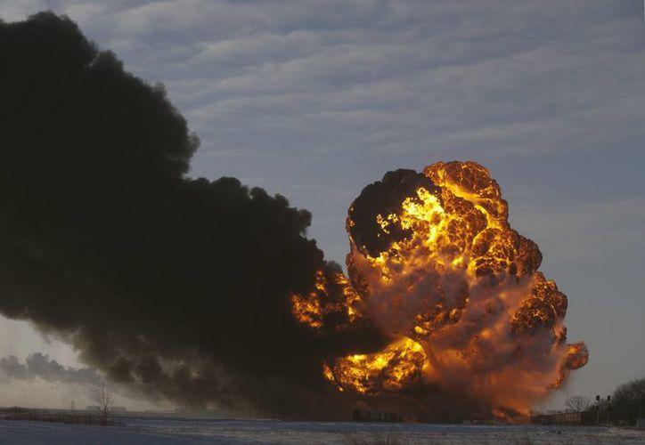 Se sabe que un tren que llevaba granos estuvo involucrado en el siniestro en Dakota del Norte, EU. (Agencias)
