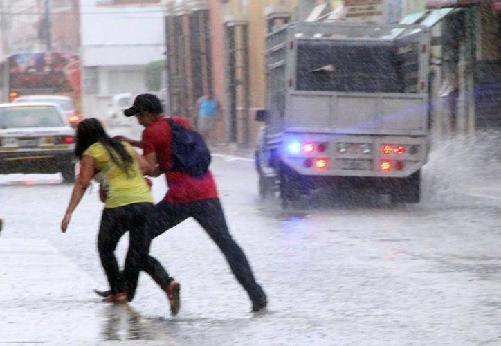A pesar de la lluvia y granizo, se pronostican temperaturas máximas de 35 a 39 grados Celsius en Yucatán. (SIPSE)