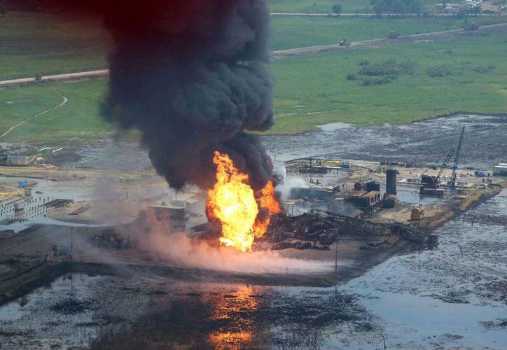 Pemex indicó semanas atrás que el incendio del pozo en Nacajuca, Tabasco, no representaba riesgo para la población. (Archivo/Notimex)