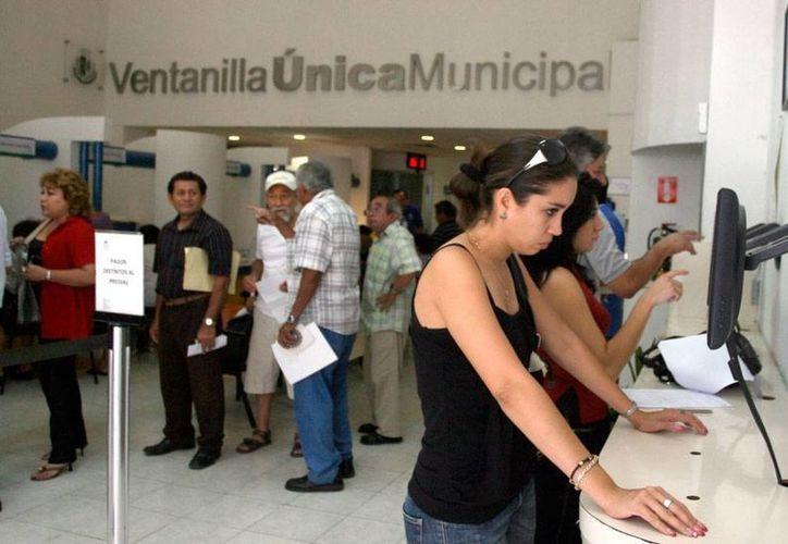 El Ayuntamiento de Mérida pretende que, como todos los yucatecos que tienen propiedades, el Gobierno del Estado pague impuesto predial. La imagen es de contexto. (Milenio Novedades)
