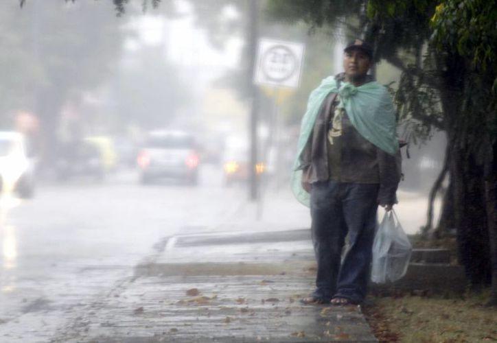 En las primeras horas de la tarde, intensas lluvias comenzaron a afectar varias zonas del estado, incluida la capital. (Archivo/SIPSE)