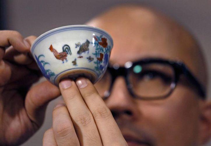 La casa de subastas Sotheby's identificó al comprador de la taza como el coleccionista Liu Yiqian. (Agencias)