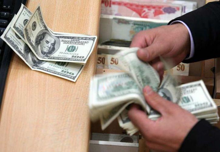 El Banco de México fijó en 18.9587 pesos el tipo de cambio. (Contexto/Internet).