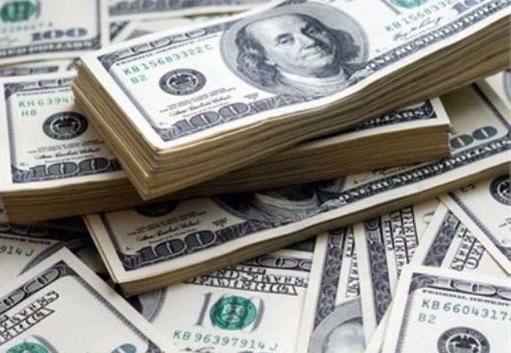 El Banco de México fijó en 19.0137 pesos el tipo de cambio. (Contexto/Internet).