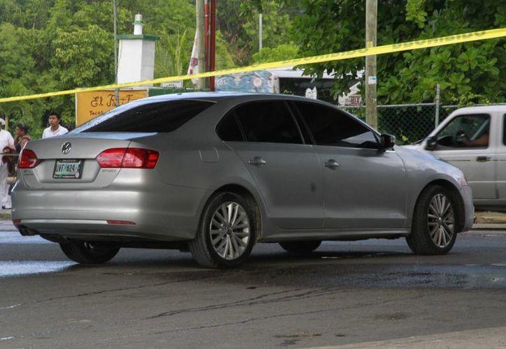 El hombre asesinado en Puerto Morelos y el ejecutado en Cancún fueron vinculados al crimen organizado. (Redacción/SIPSE)