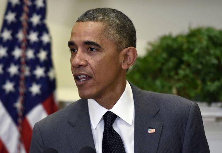 Obama estima que más estadounidenses se inscribirán al programa de cobertura de salud en 2015. (AP)