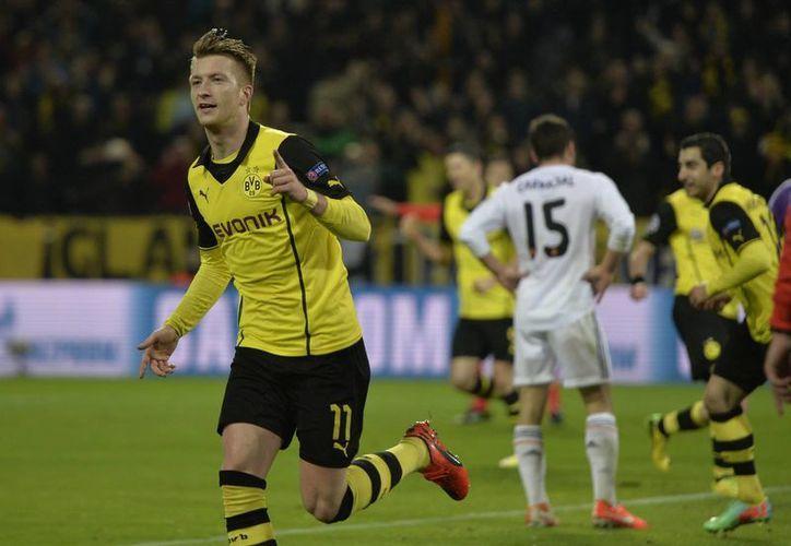 Marco Reus (d) del Borussia Dortmund fue quien anotó los dos goles en la portería del Real Madrid. (Agencias)