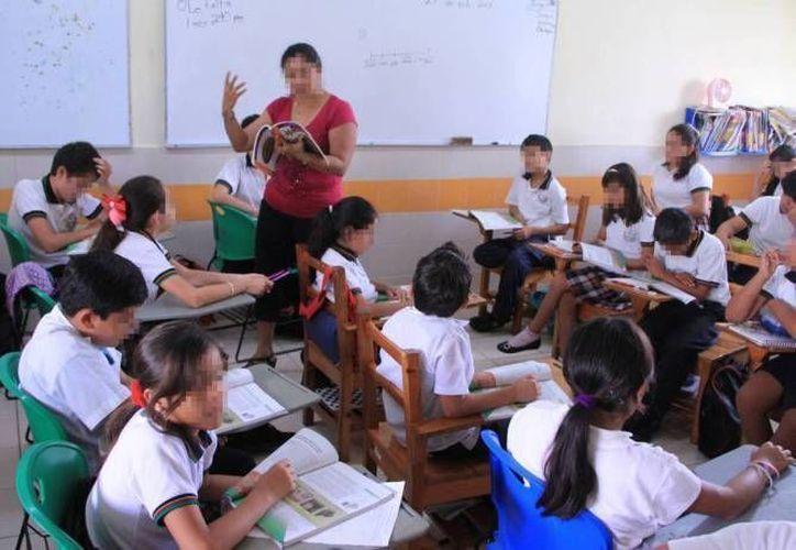 Más de 20 mil docentes, prefectos y trabajadores administrativos recibirán bonos de inicio de curso en Yucatán. (Archivo/ Milenio Novedades)