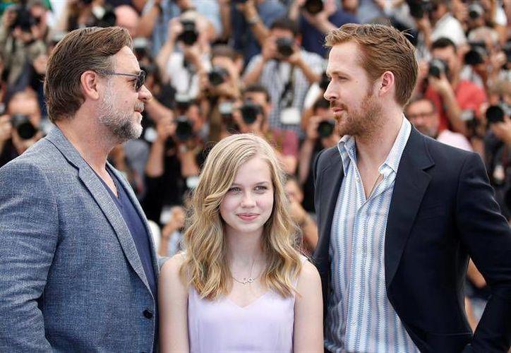Russell Crowe y Ryan Gosling estuvieron presentes este domingo en el Festival de Cannes, en el cual presentaron la cinta que ambos protagonizan 'The Nice Guys'. (EFE)