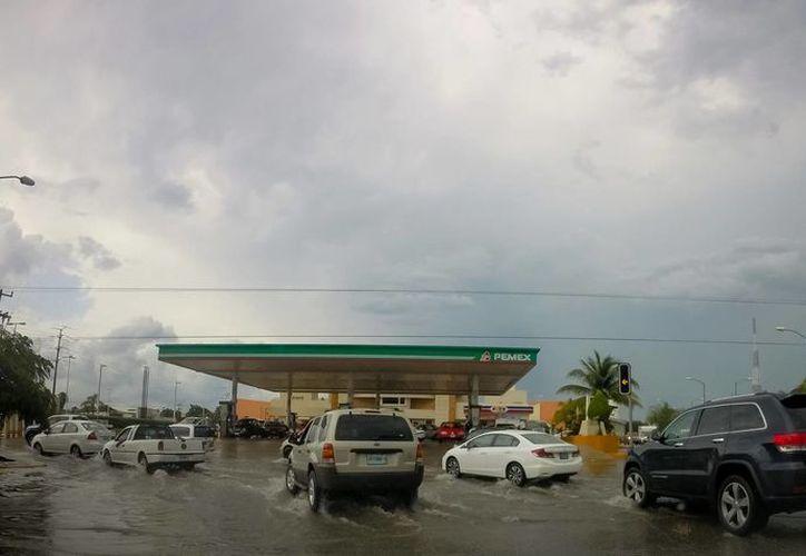 Un n canal de baja presión se localizará frente a las costas de Quintana Roo. (Archivo/Notimex)
