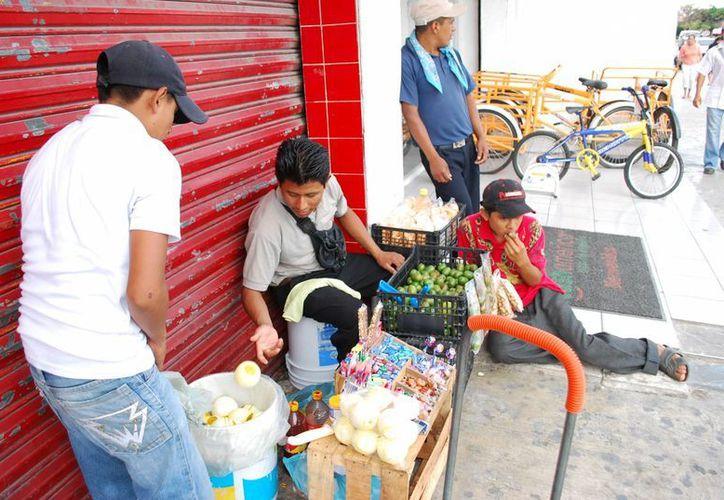 Para que un menor pueda trabajar, debe obtener un permiso de la Secretaría de Trabajo. (Tomás Álvarez/SIPSE)