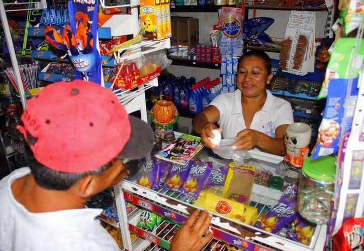 Los pequeños comercios de Mérida, con escasa actividad en esta temporada. (Milenio Novedades)