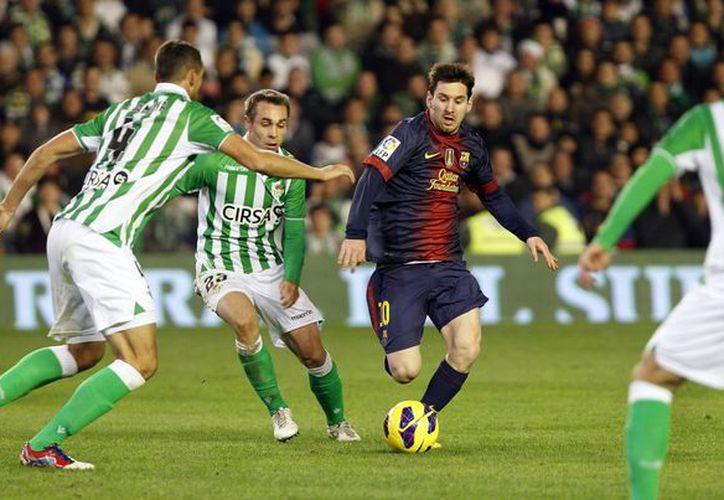 Apenas el miércoles Messi salió lesionado del partido contra Benfica, pero hoy (foto) fue una pesadilla para el Betis. (Agencias)